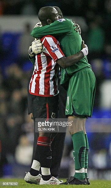 Tottenham Hotspur's Brazilian goalkeeper Heurelho Gomes hugs Sunderland's English striker Darren Bent after the English Premier League football match...