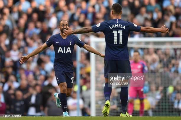 Tottenham Hotspur's Brazilian midfielder Lucas Moura celebrates scoring his team's second goal with Tottenham Hotspur's Argentinian midfielder Erik...