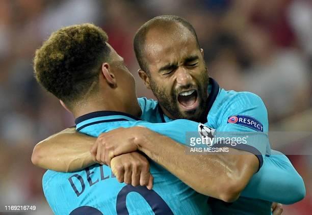 Tottenham Hotspur's Brazilian midfielder Lucas Moura celebrates with his teammate Tottenham Hotspur's English midfielder Dele Alli after scoring...