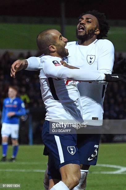 Tottenham Hotspur's Brazilian midfielder Lucas Moura celebrates with Tottenham Hotspur's English defender Danny Rose after scoring their first goal...