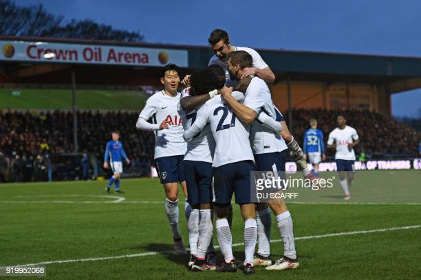 Tottenham Hotspur's Brazilian midfielder Lucas Moura celebrates with teammates after scoring their first goal during the English FA Cup fifth round...