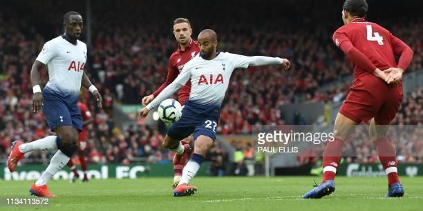Tottenham Hotspur's Brazilian midfielder Lucas Moura has an unsuccessful shot during the English Premier League football match between Liverpool and...