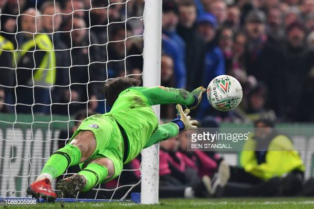 Tottenham Hotspur's Brazilian midfielder Lucas Moura has his penalty saved by Chelsea's Spanish goalkeeper Kepa Arrizabalaga in the shootout during...
