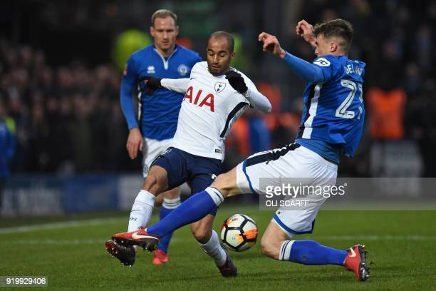 Tottenham Hotspur's Brazilian midfielder Lucas Moura is tackled by Rochdale's Irish defender Ryan Delaney during the English FA Cup fifth round...