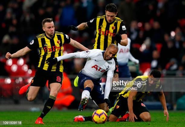 Tottenham Hotspur's Brazilian midfielder Lucas Moura reacts as he vies with Watford's English mifielder Tom Cleverley and Watford's English-born...