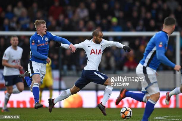 Tottenham Hotspur's Brazilian midfielder Lucas Moura runs away from Rochdale's English midfielder Andy Cannon during the English FA Cup fifth round...