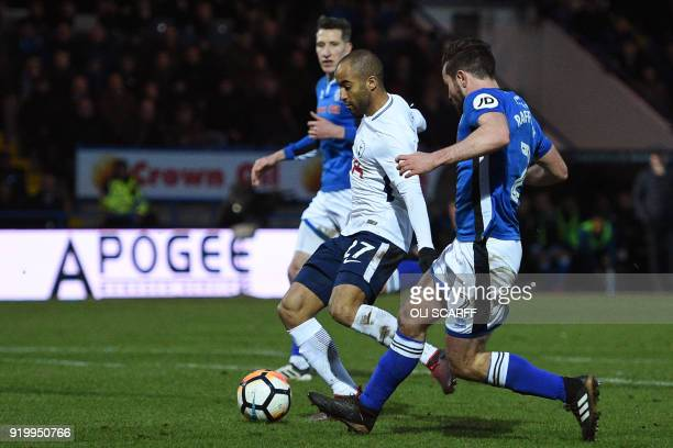 Tottenham Hotspur's Brazilian midfielder Lucas Moura shoots to score their first goal during the English FA Cup fifth round football match between...