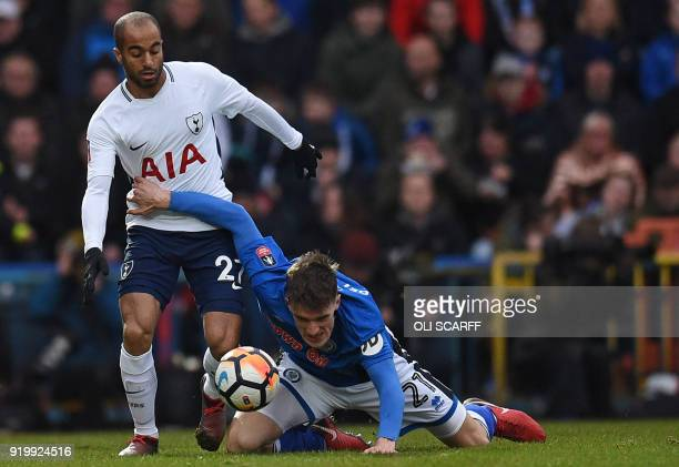 Tottenham Hotspur's Brazilian midfielder Lucas Moura vies with Rochdale's Irish defender Ryan Delaney during the English FA Cup fifth round football...
