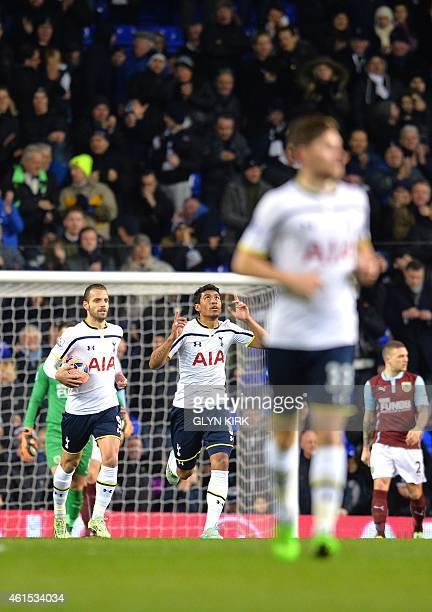 Tottenham Hotspur's Brazilian midfielder Paulinho celebrates scoring his team's first goal during the English FA Cup Third Round football match...