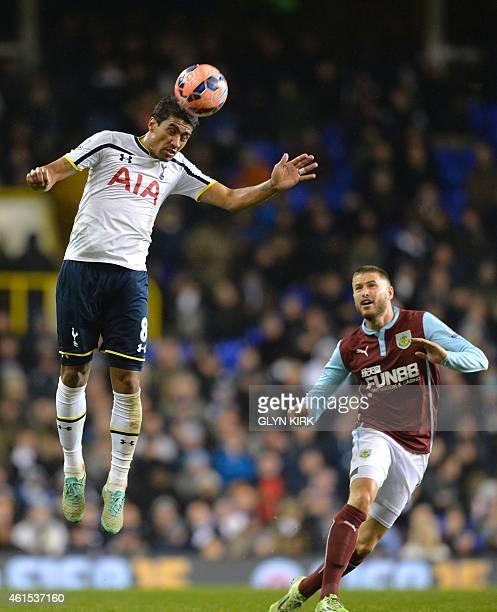 Tottenham Hotspur's Brazilian midfielder Paulinho heads the ball during the English FA Cup Third Round football match replay betweenTottenham Hotspur...