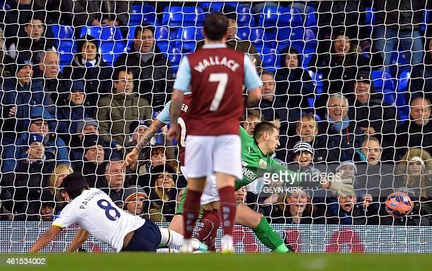 Tottenham Hotspur's Brazilian midfielder Paulinho scores his team's first goal during the English FA Cup Third Round football match replay...