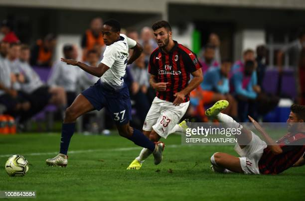 Tottenham Hotspur's British defender Kyle WalkerPeters vies for the ball with AC Milan's Italian foward Patrick Cutrone and foward Fabio Borini...