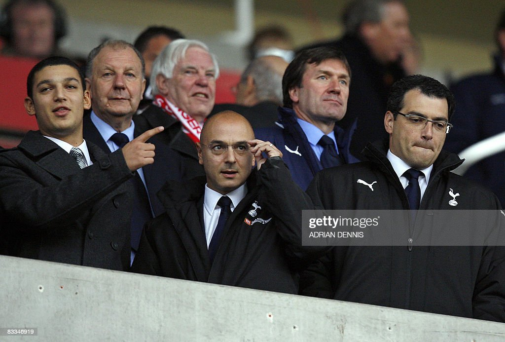 Tottenham Hotspur's Chairman Daniel Levy (C) alongside Sporting Director Damien Comolli (R) take their seats before the Premiership football match against Stoke City at The Britannia Stadium in Stoke on October 19, 2008. Stoke won the game 2-1 with Tottenham having two players sent off in the match. AFP PHOTO / Adrian Dennis Mobile and website use of domestic English football pictures are subject to obtaining a Photographic End User Licence from Football DataCo Ltd Tel : +44 (0) 207 864 9121 or e-mail accreditations@football-dataco.com - applies to Premier and Football League matches.