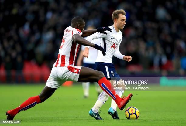 Tottenham Hotspur's Christian Eriksen and Stoke City's Kurt Zouma battle for the ball during the Premier League match at Wembley Stadium London