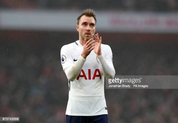 Tottenham Hotspur's Christian Eriksen appears dejected as he applauds the fans after the Premier League match at the Emirates Stadium London