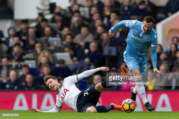 Tottenham Hotspur's Christian Eriksen battles for possession with Stoke City's Phil Bardsley during the Premier League match between Tottenham...