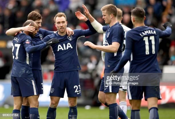 Tottenham Hotspur's Christian Eriksen celebrates scoring his side's third goal of the game with his teammates Lucas Moura Ben Davies Erik Dier and...