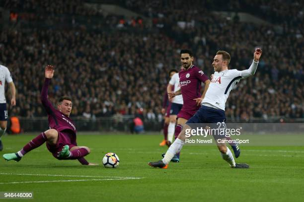 Tottenham Hotspur's Christian Eriksen scores his side's first goal during the Premier League match between Tottenham Hotspur and Manchester City at...