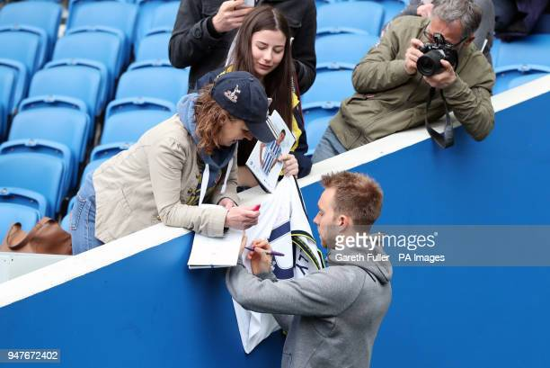 Tottenham Hotspur's Christian Eriksen signs autographs on the pitch before the Premier League match at the AMEX Stadium Brighton