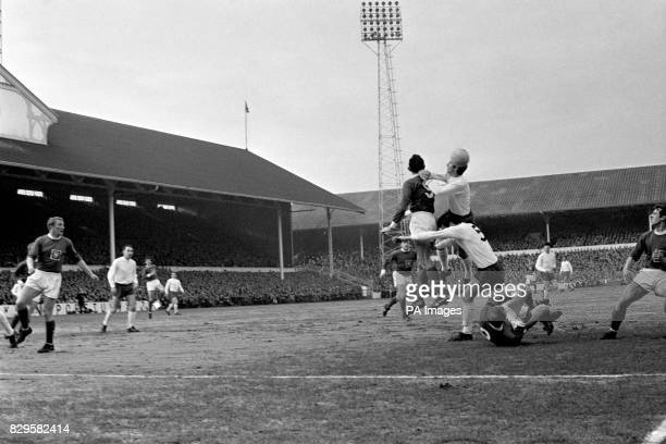 Tottenham Hotspur's Cliff Jones gets his head to the ball as he and teammate Mike England are challenged by Preston North End's Ray Charnley and Bert...