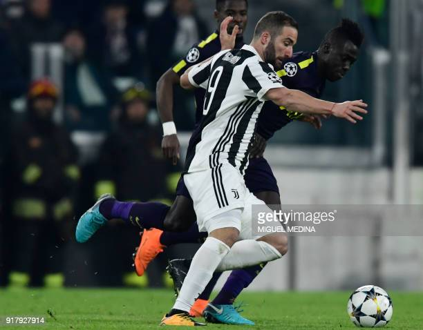 Tottenham Hotspur's Colombian defender Davinson Sanchez fights for the ball with Juventus' forward from Argentina Gonzalo Higuain during the UEFA...