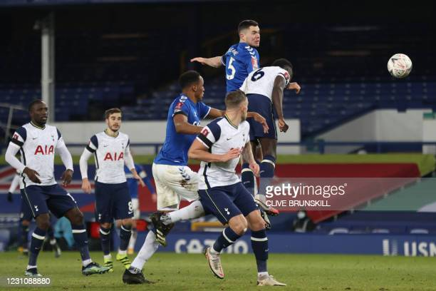 Tottenham Hotspur's Colombian defender Davinson Sanchez heads the ball during the English FA Cup fifth round football match between Everton and...