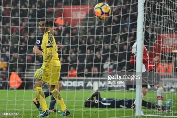 Tottenham Hotspur's Colombian defender Davinson Sanchez reacts after deflecting the ball into his own net past Tottenham Hotspur's Dutch goalkeeper...