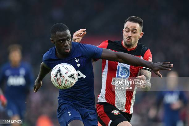 Tottenham Hotspur's Colombian defender Davinson Sanchez vies for the ball with Southampton's English striker Danny Ings during the English FA Cup...