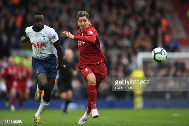Tottenham Hotspur's Colombian defender Davinson Sanchez vies with Liverpool's Brazilian midfielder Roberto Firmino during the English Premier League...