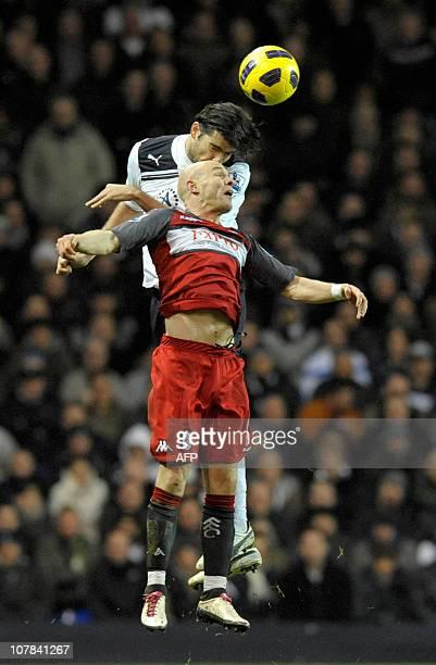 Tottenham Hotspur's Croatian defender Vedran Corluka vies with Fulham's English striker Andrew Johnson during the English Premier League football...