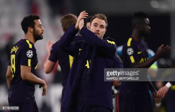 Tottenham Hotspur's Danish midfielder Christian Eriksen applauds supporters after the UEFA Champions League round of sixteen first leg football match...