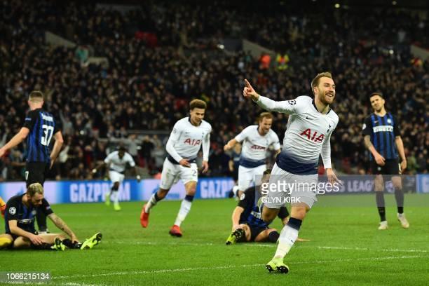 Tottenham Hotspur's Danish midfielder Christian Eriksen celebrates after scoring the opening goal of the UEFA Champions League group B football match...