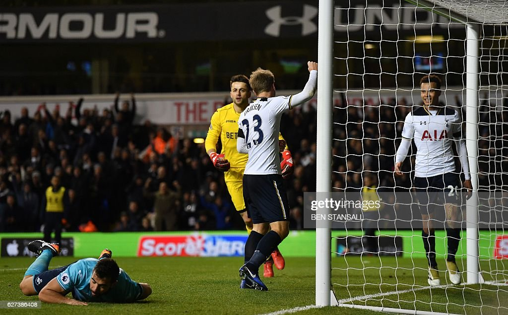 Tottenham Hotspur's Danish midfielder Christian Eriksen (C) celebrates scoring his team's fifth goal during the English Premier League football match between Tottenham Hotspur and Swansea City at White Hart Lane in London, on December 3, 2016. Tottenham won the match 5-0. / AFP / Ben STANSALL / RESTRICTED TO EDITORIAL USE. No use with unauthorized audio, video, data, fixture lists, club/league logos or 'live' services. Online in-match use limited to 75 images, no video emulation. No use in betting, games or single club/league/player publications. /