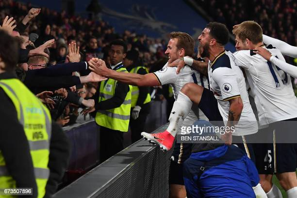 Tottenham Hotspur's Danish midfielder Christian Eriksen celebrates scoring the opening goal with teammates during the English Premier League football...