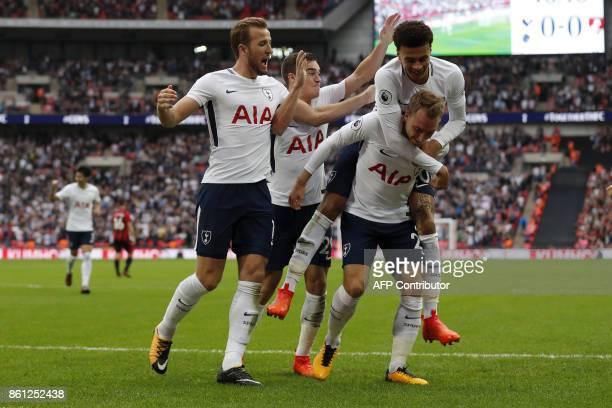 Tottenham Hotspur's Danish midfielder Christian Eriksen celebrates with Tottenham Hotspur's English midfielder Dele Alli Tottenham Hotspur's English...
