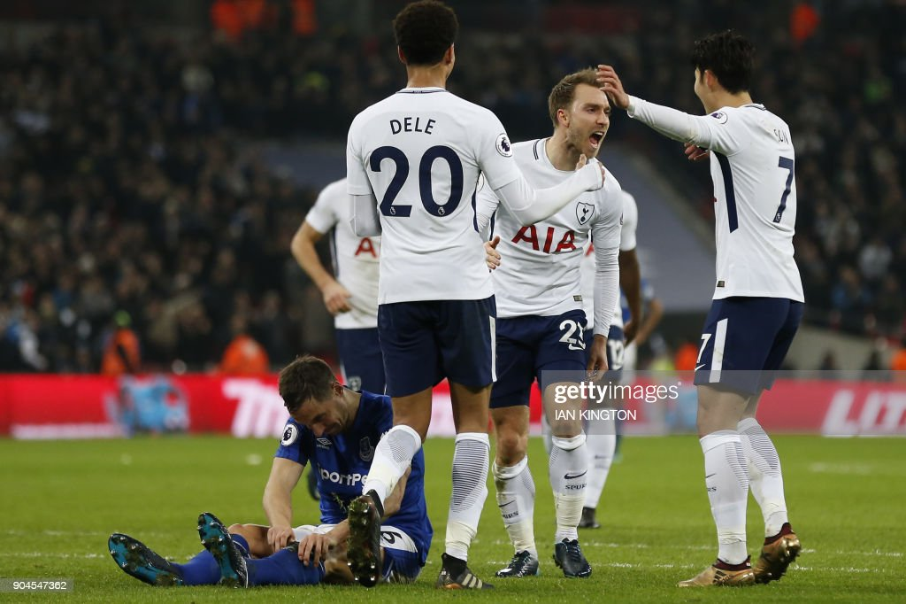Tottenham Hotspur's Danish midfielder Christian Eriksen (C) celebrates with Tottenham Hotspur's South Korean striker Son Heung-Min (R) and Tottenham Hotspur's English midfielder Dele Alli, scoring the team's fourth goal during the English Premier League football match between Tottenham Hotspur and Everton at Wembley Stadium in London, on January 13, 2018. / AFP PHOTO / Ian KINGTON / RESTRICTED TO EDITORIAL USE. No use with unauthorized audio, video, data, fixture lists, club/league logos or 'live' services. Online in-match use limited to 75 images, no video emulation. No use in betting, games or single club/league/player publications. /