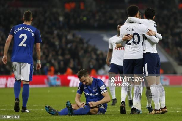 Tottenham Hotspur's Danish midfielder Christian Eriksen celebrates with Tottenham Hotspur's South Korean striker Son HeungMin and Tottenham Hotspur's...