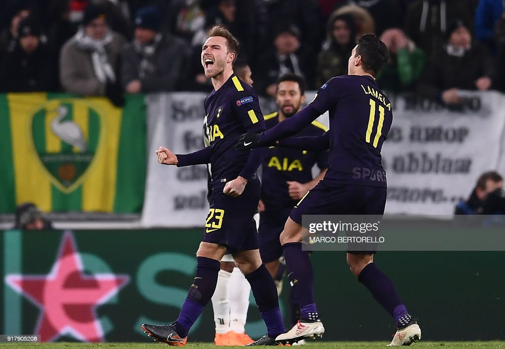 Tottenham Hotspur's Danish midfielder Christian Eriksen (C) celebrates scoring his team's second goal during the UEFA Champions League round of sixteen first leg football match between Juventus and Tottenham Hotspur at The Allianz Stadium in Turin on February 13, 2018. / AFP PHOTO / Marco BERTORELLO