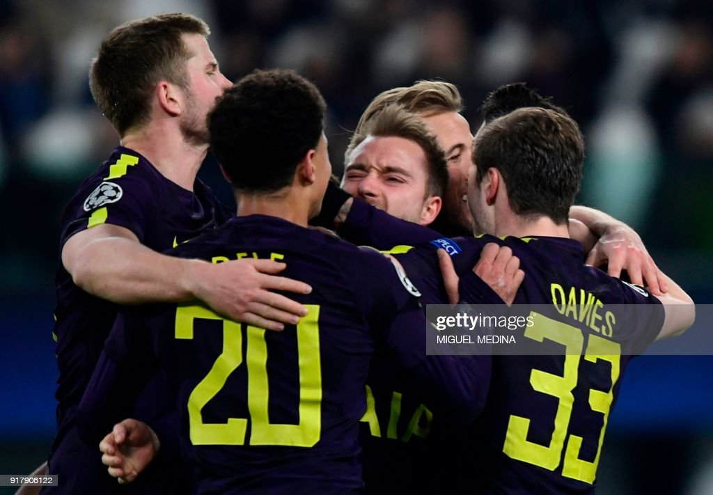 Tottenham Hotspur's Danish midfielder Christian Eriksen (C) celebrates with teammates after scoring his team's second goal during the UEFA Champions League round of sixteen first leg football match between Juventus and Tottenham Hotspur at The Allianz Stadium in Turin on February 13, 2018. / AFP PHOTO / Miguel MEDINA
