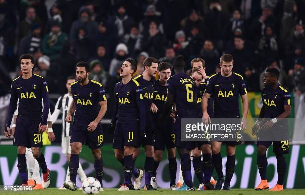 Tottenham Hotspur's Danish midfielder Christian Eriksen celebrates with teammates after scoring his team's second goal during the UEFA Champions...