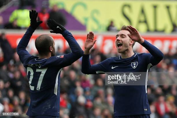 Tottenham Hotspur's Danish midfielder Christian Eriksen celebrates scoring their third goal with Tottenham Hotspur's Brazilian midfielder Lucas Moura...