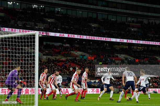 Tottenham Hotspur's Danish midfielder Christian Eriksen has a unsuccessful shot during the English Premier League football match between Tottenham...