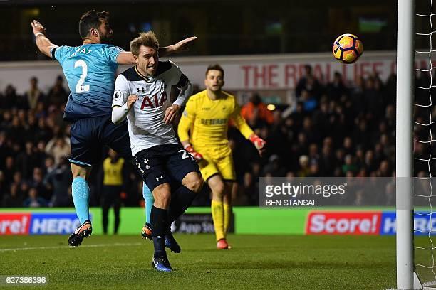 Tottenham Hotspur's Danish midfielder Christian Eriksen heads the ball to score his team's fifth goal during the English Premier League football...