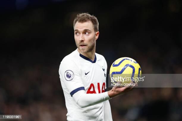 Tottenham Hotspur's Danish midfielder Christian Eriksen holds the ball during the English Premier League football match between Tottenham Hotspur and...