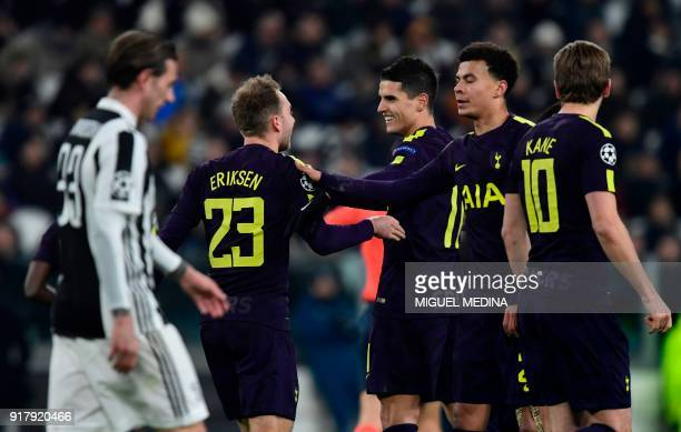 Tottenham Hotspur's Danish midfielder Christian Eriksen is congratulated by teammate English midfielder Dele Alli during the UEFA Champions League...