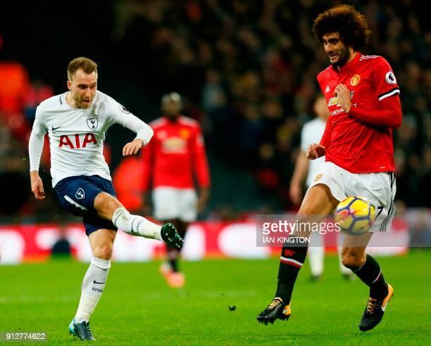 Tottenham Hotspur's Danish midfielder Christian Eriksen plays the ball past Manchester United's Belgian midfielder Marouane Fellaini during the...