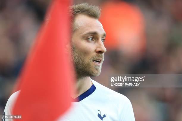 Tottenham Hotspur's Danish midfielder Christian Eriksen prepares to take a corner during the English FA cup third round football match between...