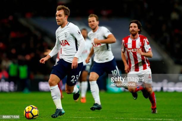 Tottenham Hotspur's Danish midfielder Christian Eriksen runs in before shooting to score their fifth goal during the English Premier League football...