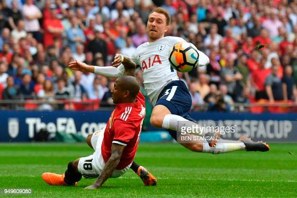 Tottenham Hotspur's Danish midfielder Christian Eriksen shoots as Manchester United's English midfielder Ashley Young defends during the English FA...
