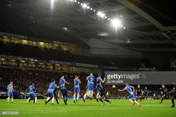 Tottenham Hotspur's Danish midfielder Christian Eriksen takes a free kick during the English Premier League football match between Brighton and Hove...